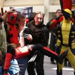 Cosplayers dressed as Deadpool and Wolverine
