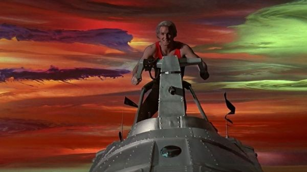 Flash Gordon riding a rocket cycle.