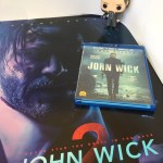 John Wick Funko doll, Blu-ray, and poster