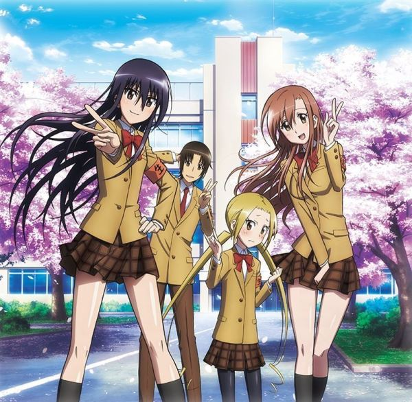 Four main characters from Seitokai Yakuindomo facing the camera; the school and a row of blooming cherry trees are behind them