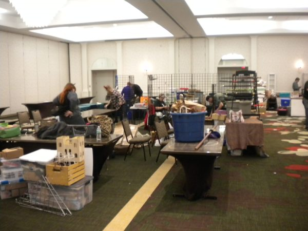 A large room cluttered with tables and boxes