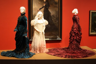 Three mannequins wearing ornate dresses