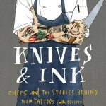 the jacket for the book, which has the torso of a chef in a chef's jacket, apron, arms folded to show off tattoos, holding a knif, and the title for Knives and Ink etc