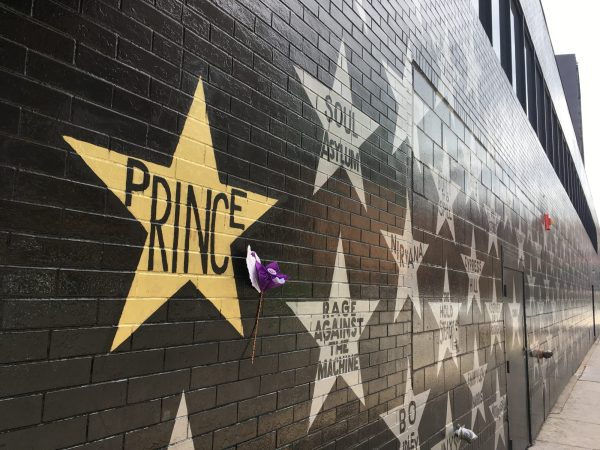 The brick exterior of the First Avenue nightclub in Minneapolis, with its trademark silver stars listing artists who have played there; Prince's star is in gold.