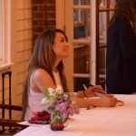 Mayte Garcia signing a copy of her memoir Tuesday night. Photo by Paul Patane