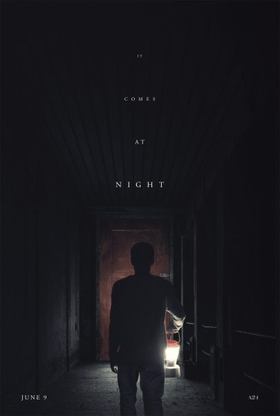 Promotional poster for It Comes at Night, featuring a silhouetted man holding a lantern in a dark hallway.