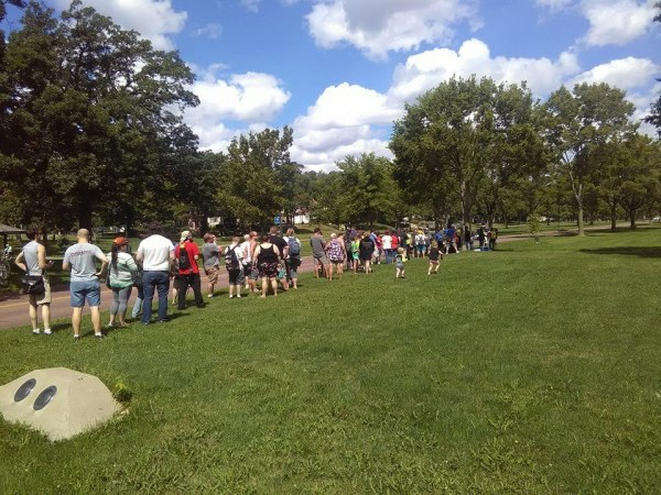 A line of people gather to play Pokemon GO.