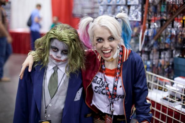 Joker and Harley Quinn Cosplayers pose for the camera