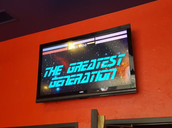Monitor showing the Greatest Generation logo