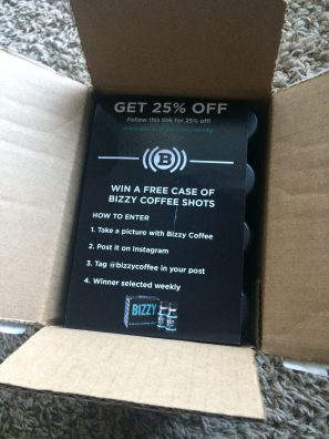 A piece of paper in box detailing how to win a free case of Bizzy Coffee shots