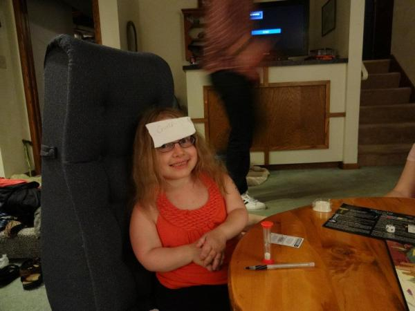 The author with a card on her head