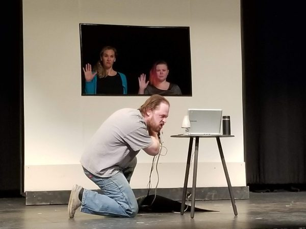 "Dave (Jason Kruger) argues with SIRI (Angela Fox) and ALEXA (Breanna Cecile) in ""With Friends Like These."""