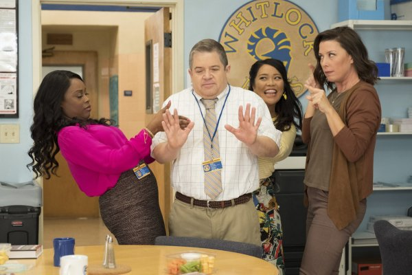 Patton Oswalt as Principal Durbin, being pressured towards a vegetable tray by three female faculty members.