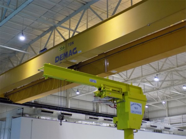 Yellow bean stretching across ceiling, with a crane attached to it, bar says DEMAC.