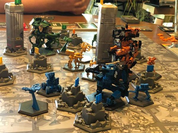 Robots and buildings on the board