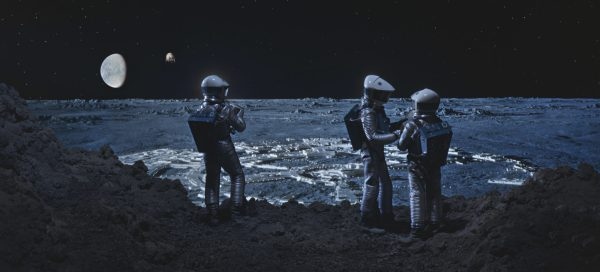 Astronauts with a view of space behind them