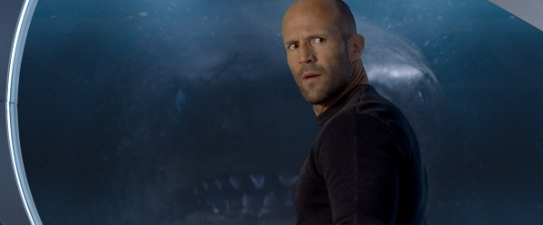 Jason Statham in front of a shark face