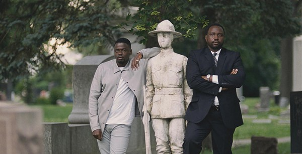 Daniel Kaluuya and Brian Tyree Henry in a cemetery