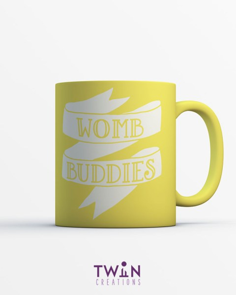 womb banner mug yellow