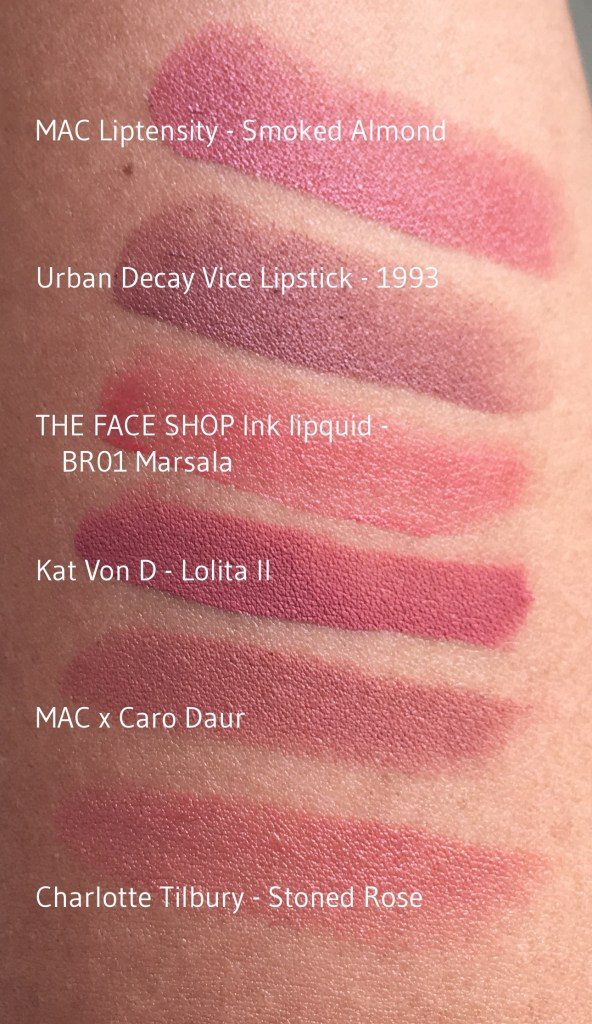 Swatches (top to bottom): MAC Liptensity in Smoked Almond, Urban Decay Vice Lipstick in 1993, The Face Shop Ink Lipquid in BR01 Marsala, Kat von D Lolita II, MAC Caro Daur, Charlotte Tilbury Stoned Rose