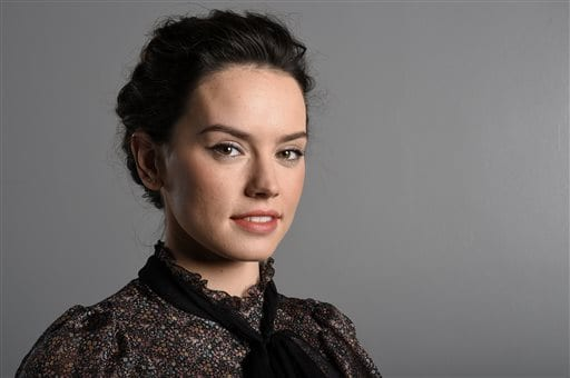 """In this Sunday, Dec. 6, 2015 photo, actress Daisy Ridley poses for a photo during a promotion for the new film, """"Star Wars: The Force Awakens,"""" in Los Angeles. Ridley stars as Rey in the J.J. Abrams directed movie opening in U.S. theaters on Dec. 18, 2015. (Photo by Jordan Strauss/Invision/AP)"""