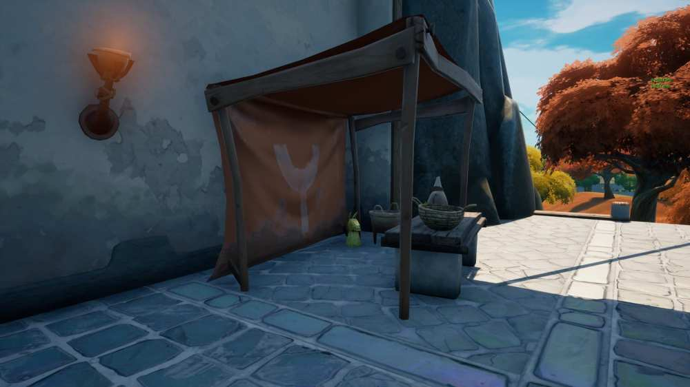where to find golden artifacts near the spire in Fortnite