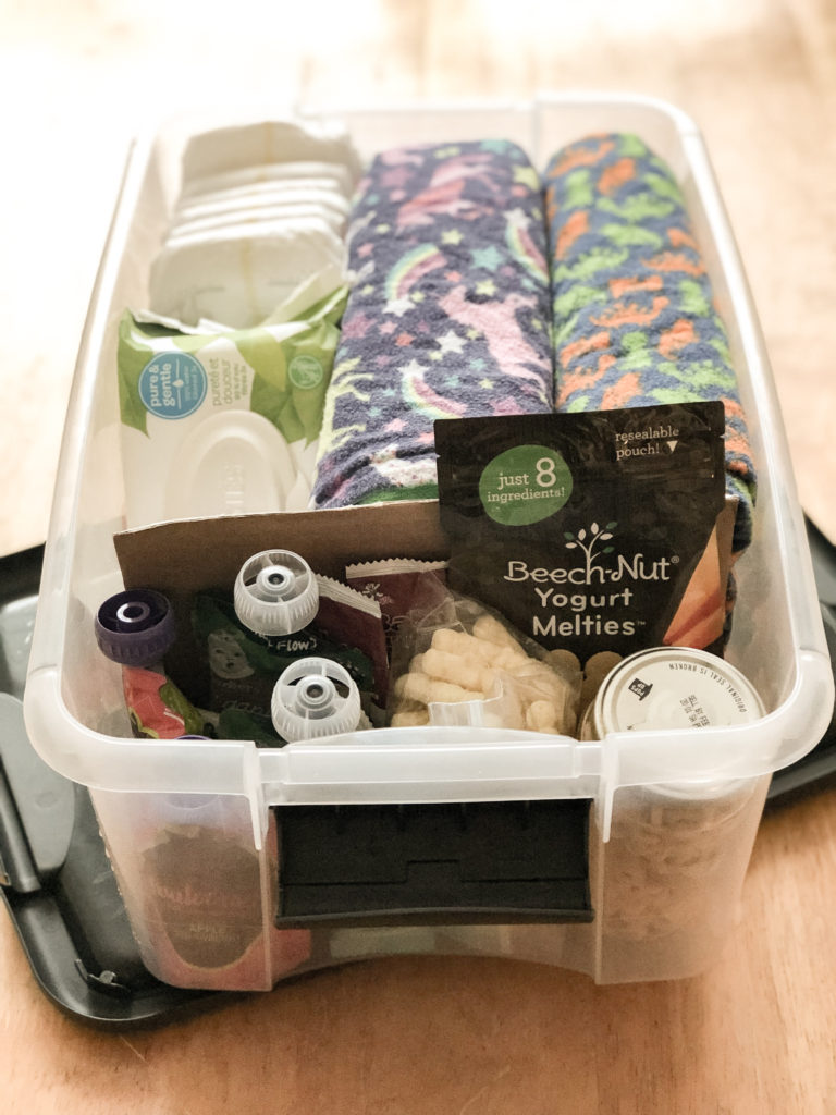Road trips with toddlers can be hard. Check out my tips and hacks for a stress free road trip with young toddlers and babies. Perfect for the long holiday car rides. Including a car box filled with toddler essentials.