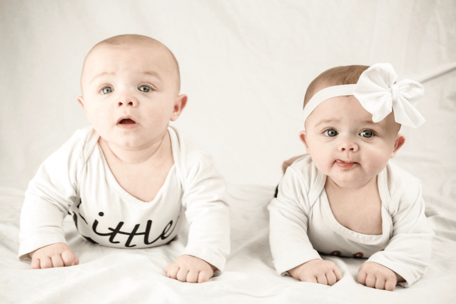 picture of boy girl twins with article, top ten questions asked about twins