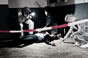 A cross processed murder scene with two forensic analysts and a police lieutenant investigating a crime on a businessman in a basement