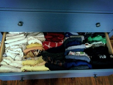 Color-organized clothing drawers.