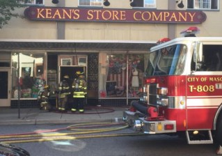 Firefighters assess damage to Kean's Department Store. Twisted Fiber Art is located on the lower level of this building. (Photo: Justin A Hinklet/The Lansing State Journal)