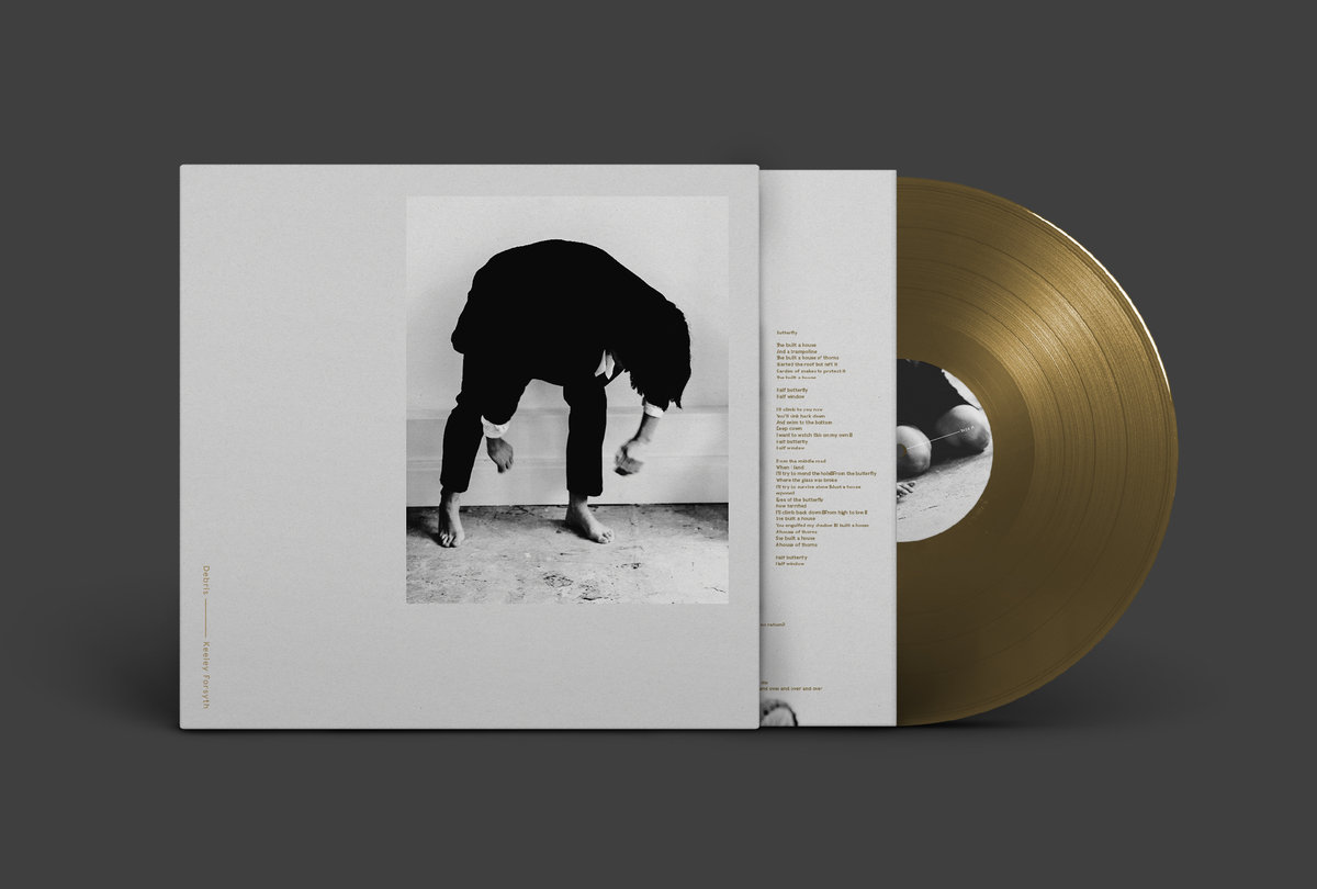 Debris cover art and gold vinyl LP.