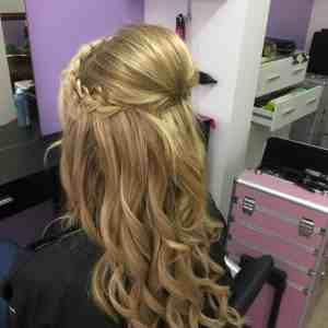 Blond curls with a plait