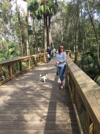 Woody leading the way on the boardwalk along the river. Cute babe he is with, too!