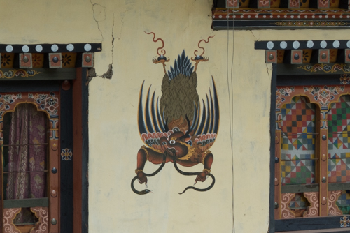 Painted on many houses, Garuda is a large mythical bird, bird-like creature that appears in both Hindu and Buddhist mythology.  Buddhists believe that it protects against evil spirits.  As an aside, Garuda is the national symbol for both Thailand and Indonesia.