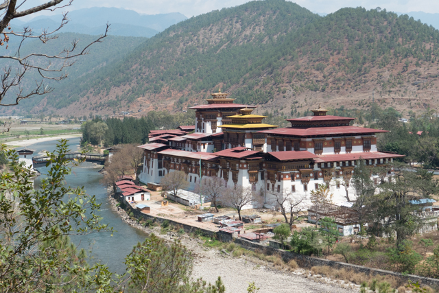 A view of the Punakha Dzong, the old capital of Bhutan (until 1955), at the confluence of Pho Chu and Mo Chu rivers.  It is the second oldest and second largest dzong in Bhutan and one of its most majestic structures.  It was the site of the wedding of the current King of Bhutan in 2011.