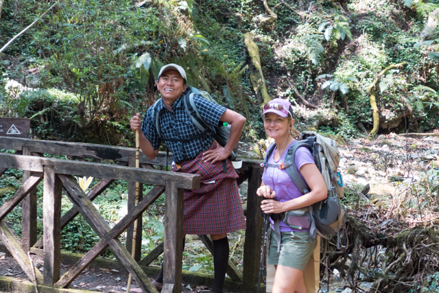 Jigme (ever smiling) with Shauna in the Royal Botanical Forest.