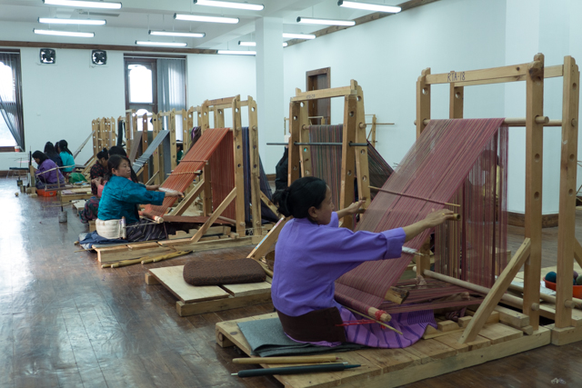 Women working at the loom at the Bhutan School of Traditional Arts.