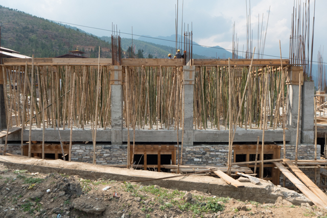Bamboo supporting concrete molds.