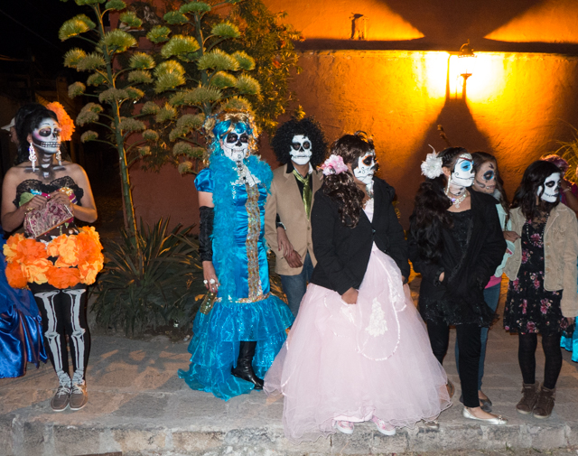 The Day of the Dead parade gets underway.