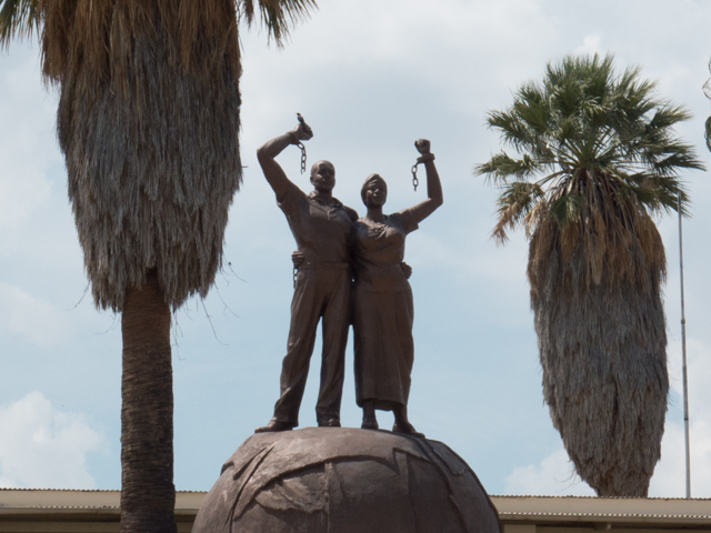 Near the Independence Museum, this statue depicts a man and woman standing on a dome, breaking the chains of colonialism. Underneath the dome is a wall showing hanged prisoners.   The site of the museum was formerly a concentration camp where Herero and Nama people were tortured and murdered during German colonial rule.   Interesting that this statue was cast by the same North Korean company that built the museum.