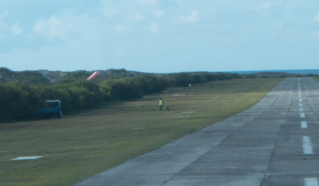 Before we could take off, the giant tortoises had to be coaxed off of the runway.