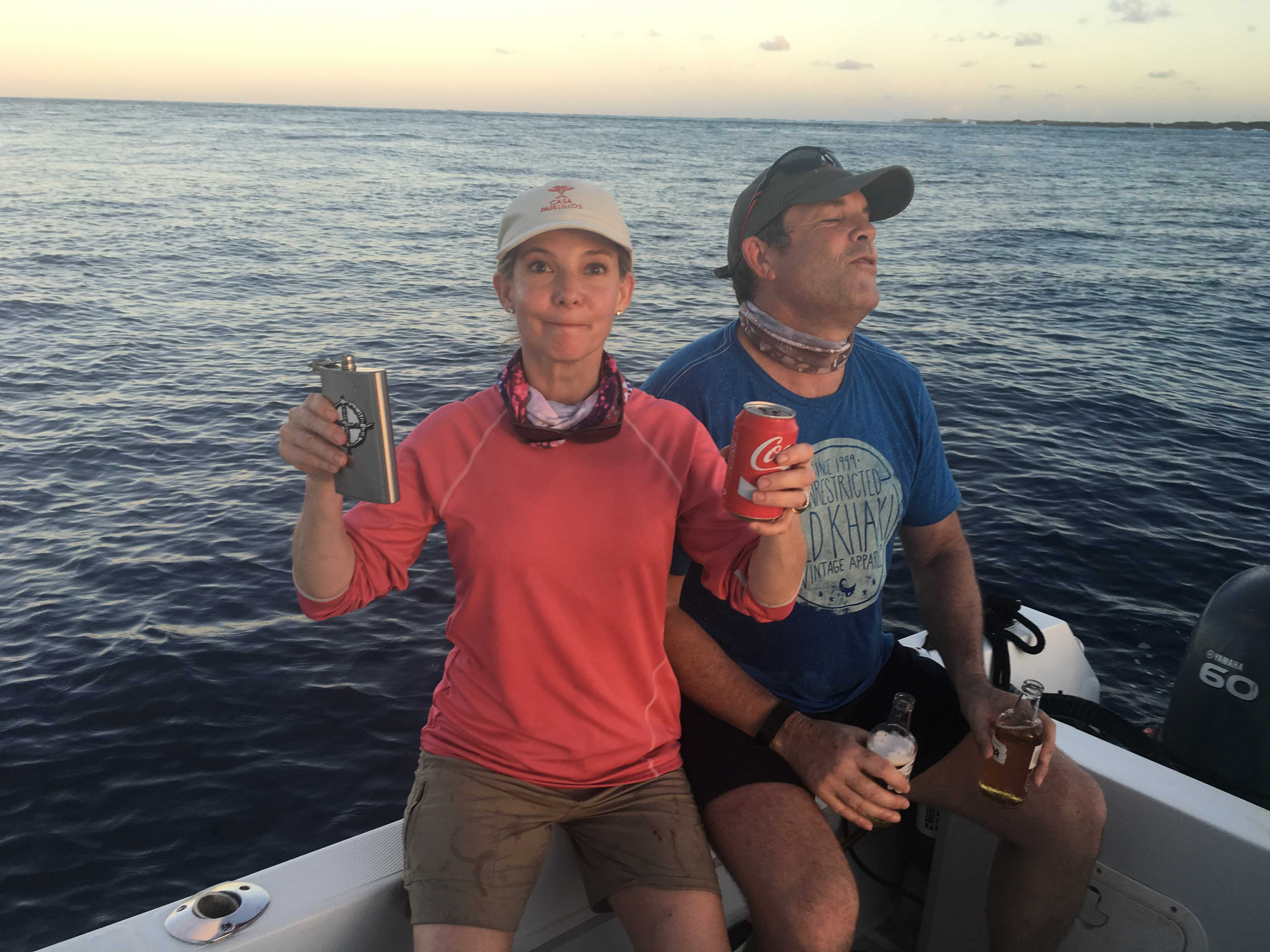 Eugenia completes the ritual Speed Ball - tequila and coke, mixed in your mouth - to celebrate the fishing success.