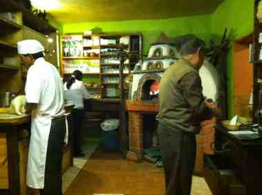 Open kitchen of an Italian restaurant in Cusco
