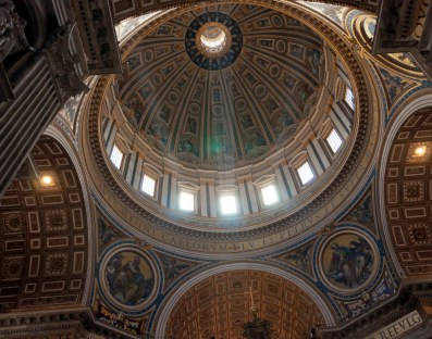 Rays of light shining through the dome of St Peter's, Vatican City