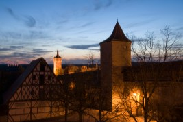 Rothenburg ob de Tauber's medieval wall and towers lit up