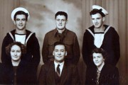 Grandfather Charlie in uniform standing between is friends in the navy.