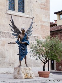 Angel statue outside Verona Cathedral