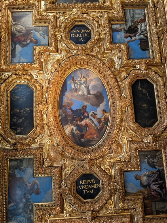 Paintings inset to gold leave frames on Doge's Palace ceiling, Venice, Italy