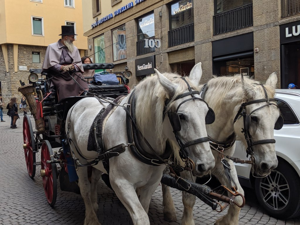 Horse-drawn carriage in Florence, Italy on All Saints Day